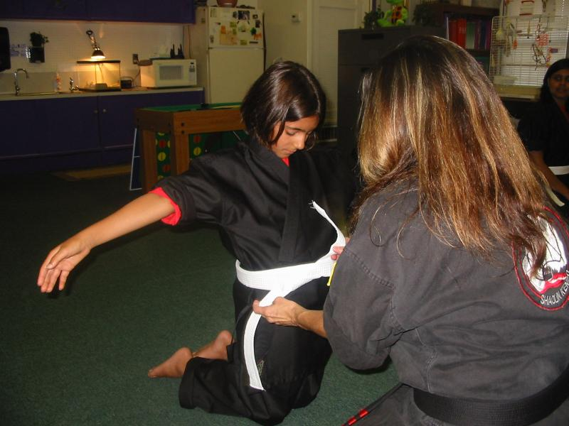 Hannah receiving White Belt